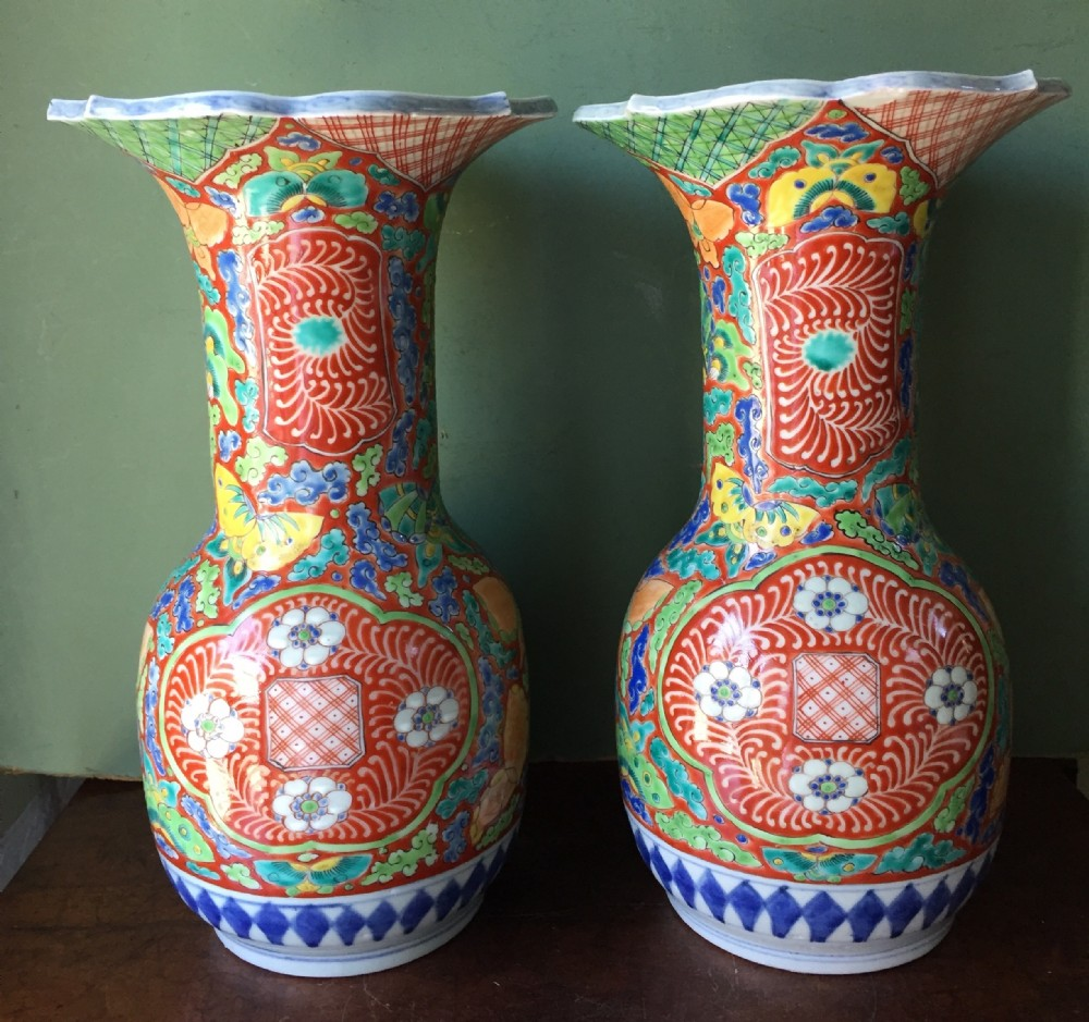 pair of late c19th japanese enamel decorated porcelain vases in stylised imari palette probably by fukagawa factory of tokyo