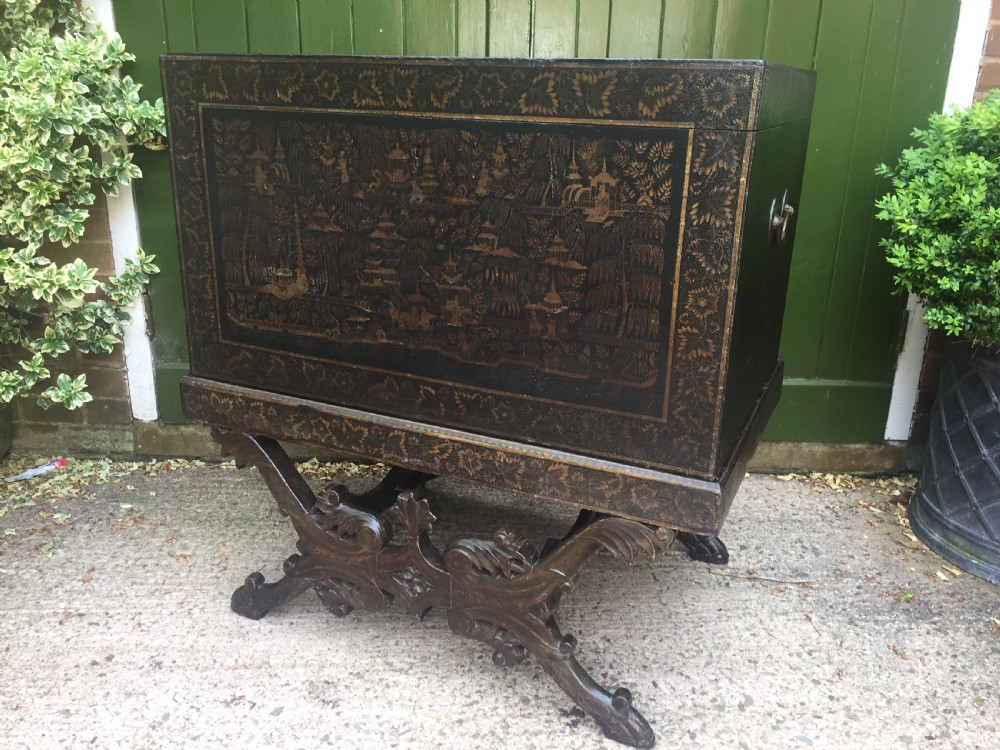 rare and decorative mid c19th indian painted and lacquered trunk on carved stand from bareilly