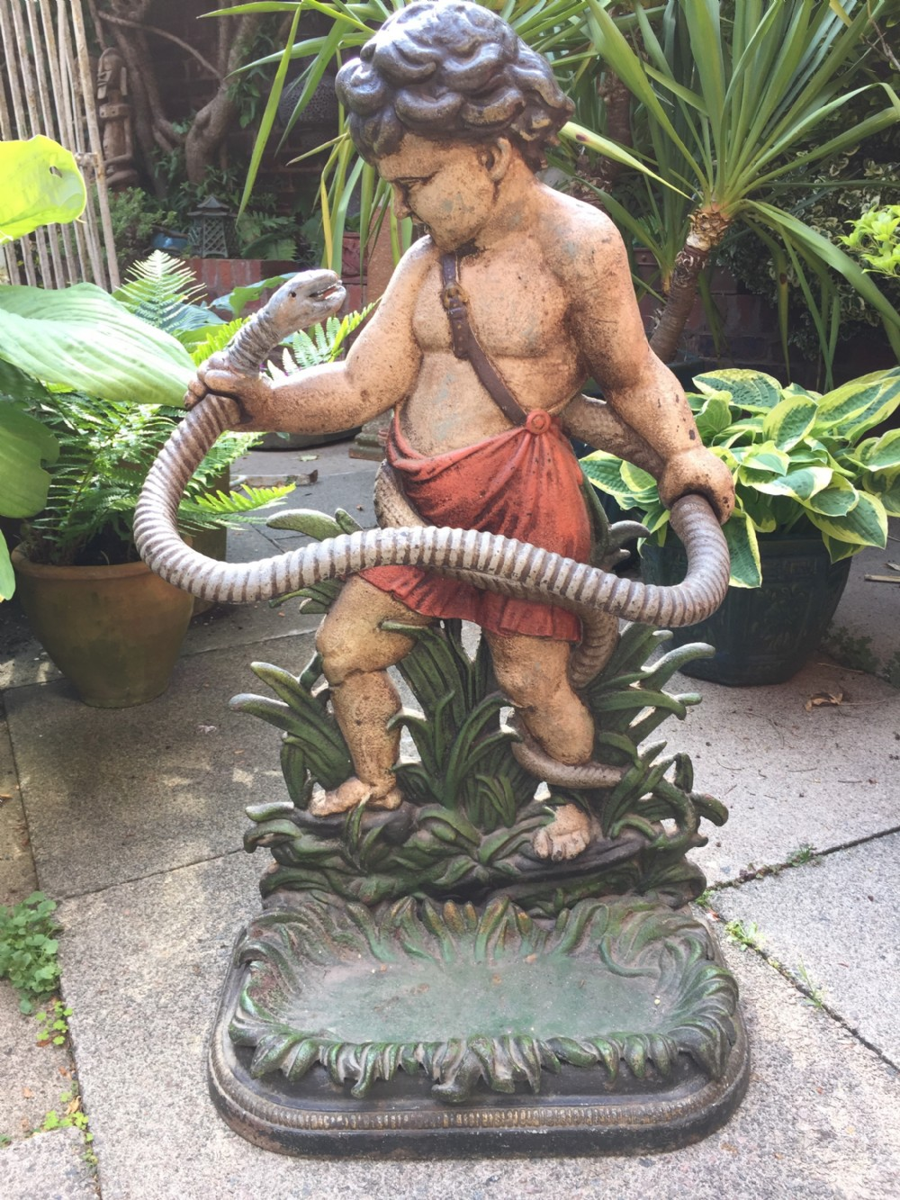 mid c19th castiron stickstand depicting the young hercules