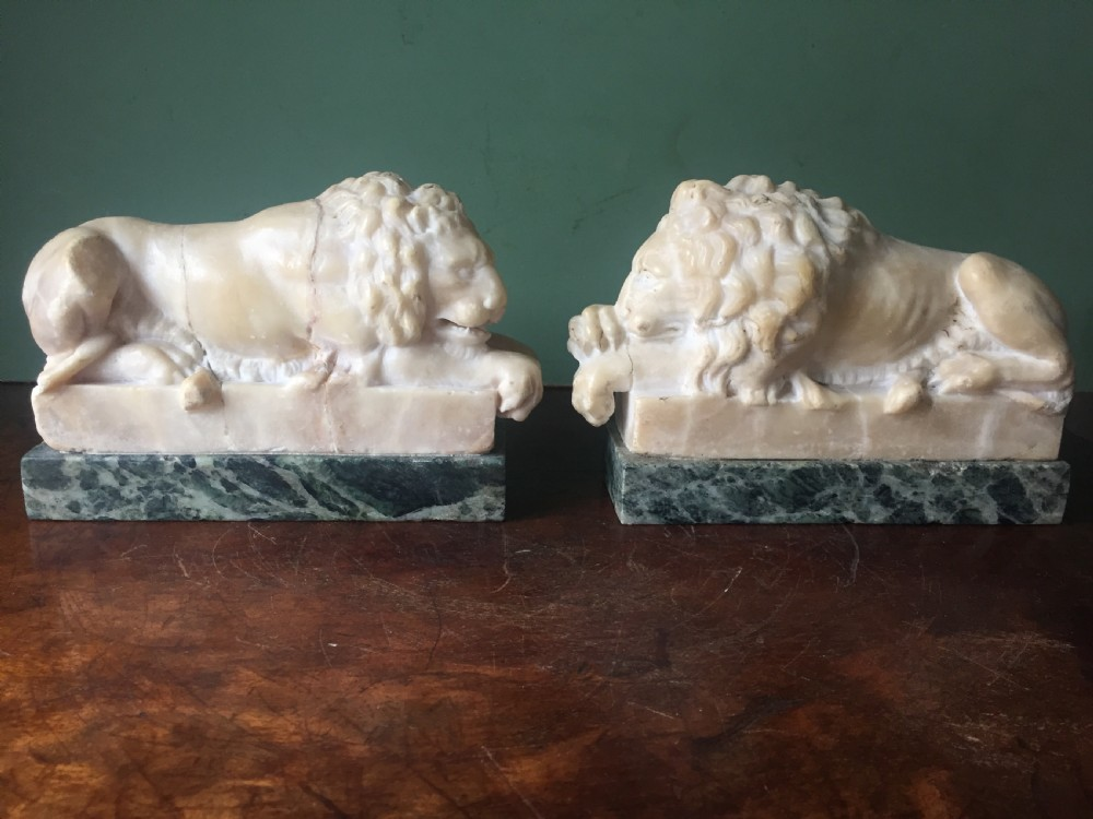 pair of c19th italian carved alabaster 'grand tour' souvenir lions after antonio canova