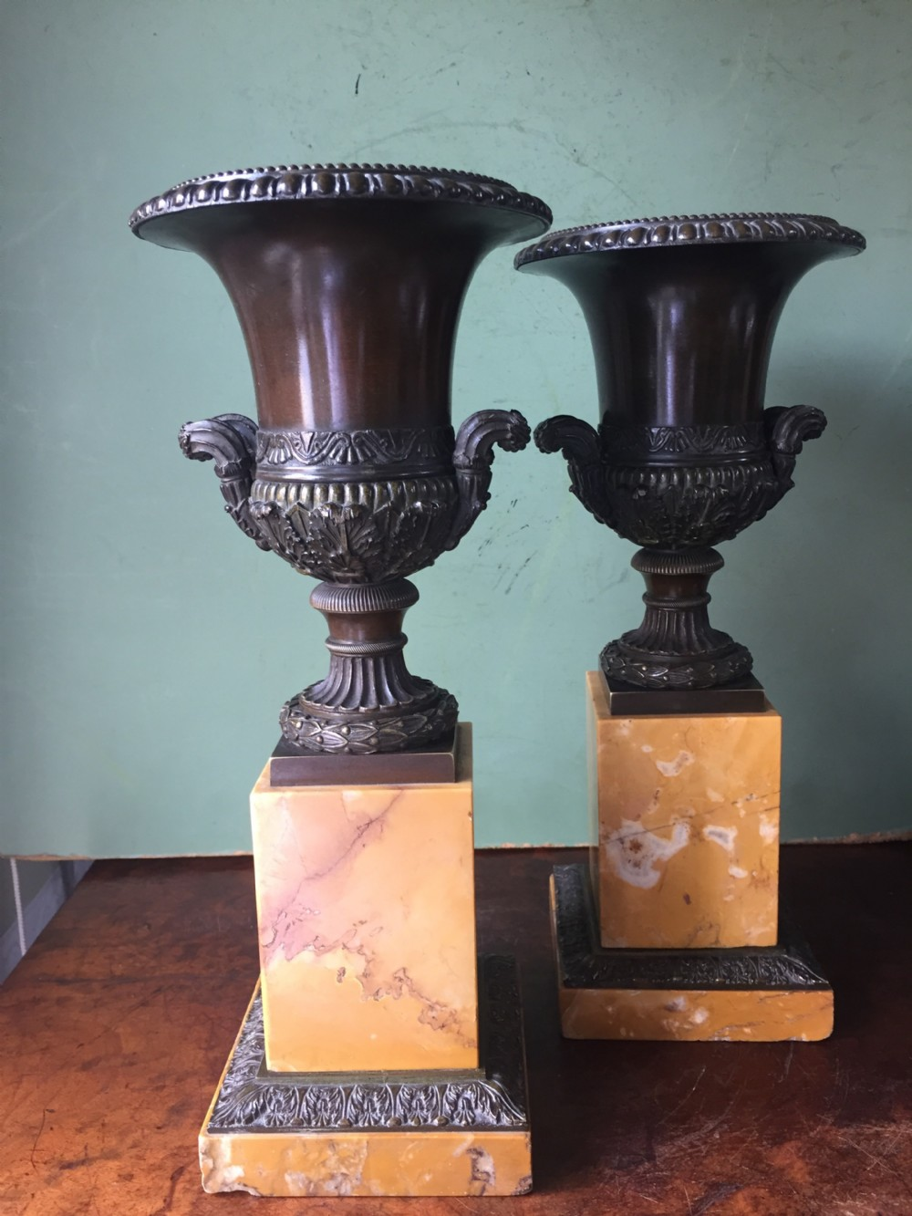pair of french early c19th charles x period bronze campana shaped urns on siena marble plinth bases
