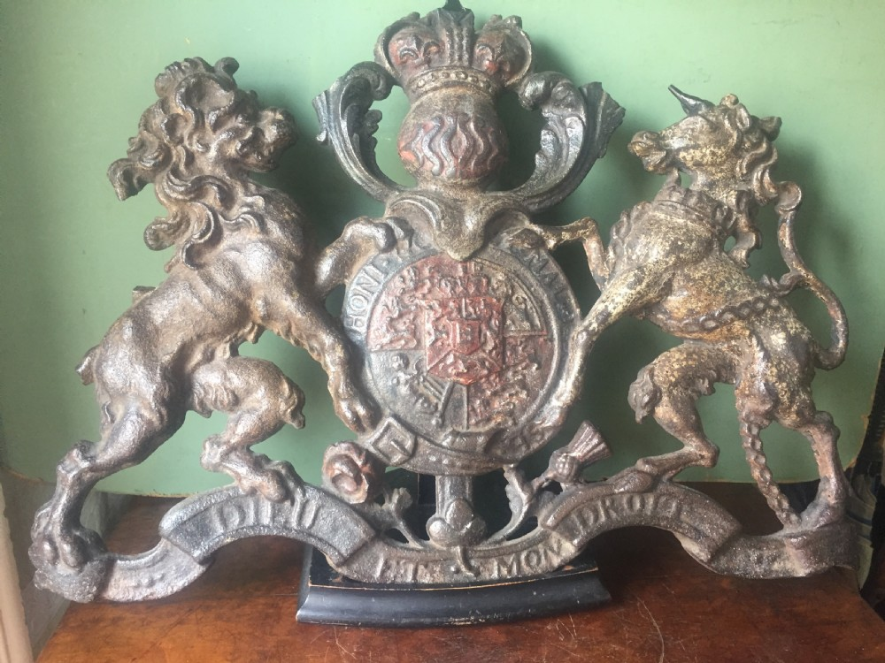 mid c19th british castiron 'coat of arms' or royal cypher with traces of original polychrome painted decoration