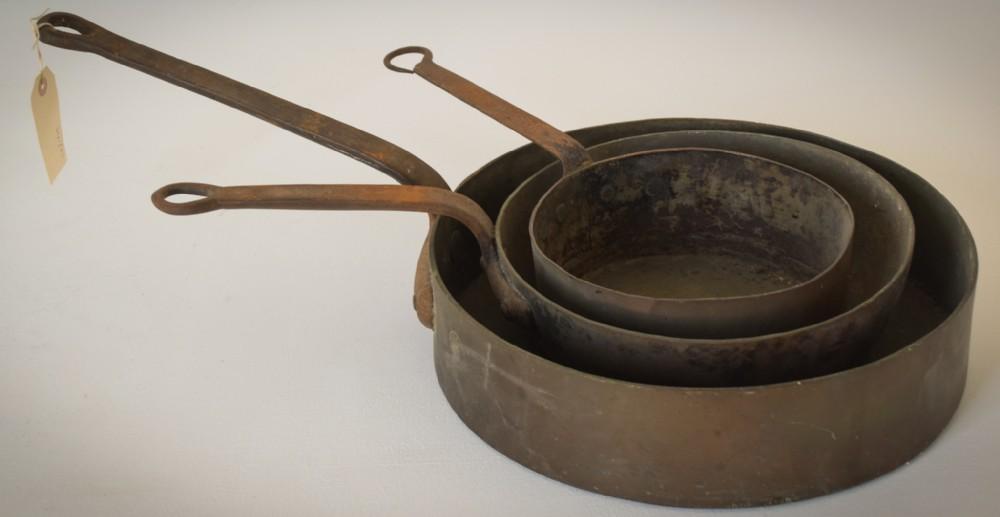 three unusual antique copper and iron handled saucepans