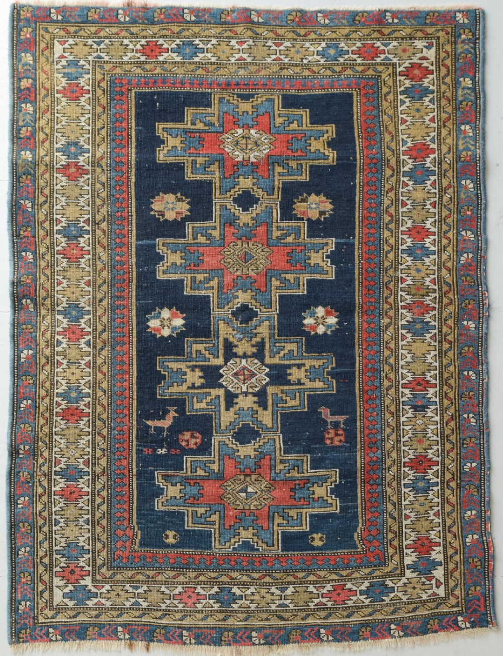hand made blue ground persian rug with bird type figures