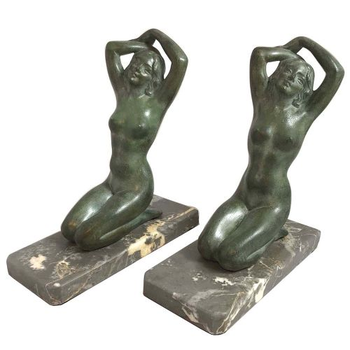 pair of art deco patinated spelter and marble figural book ends by m font
