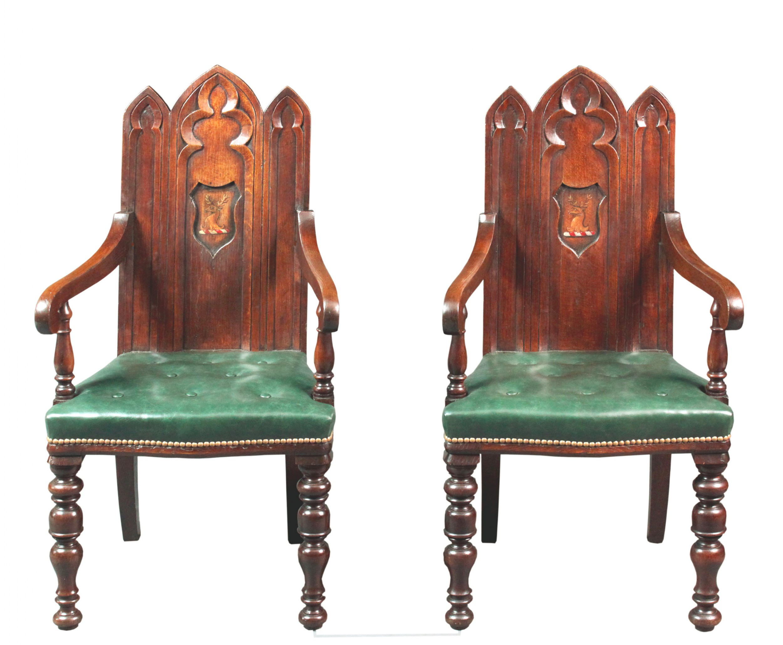 a pair of armorial gothic oak hall chairs with arms