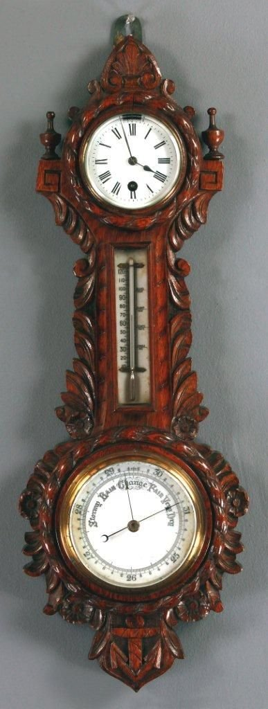 a late 19th century carved oak aneroid barometertimepiece
