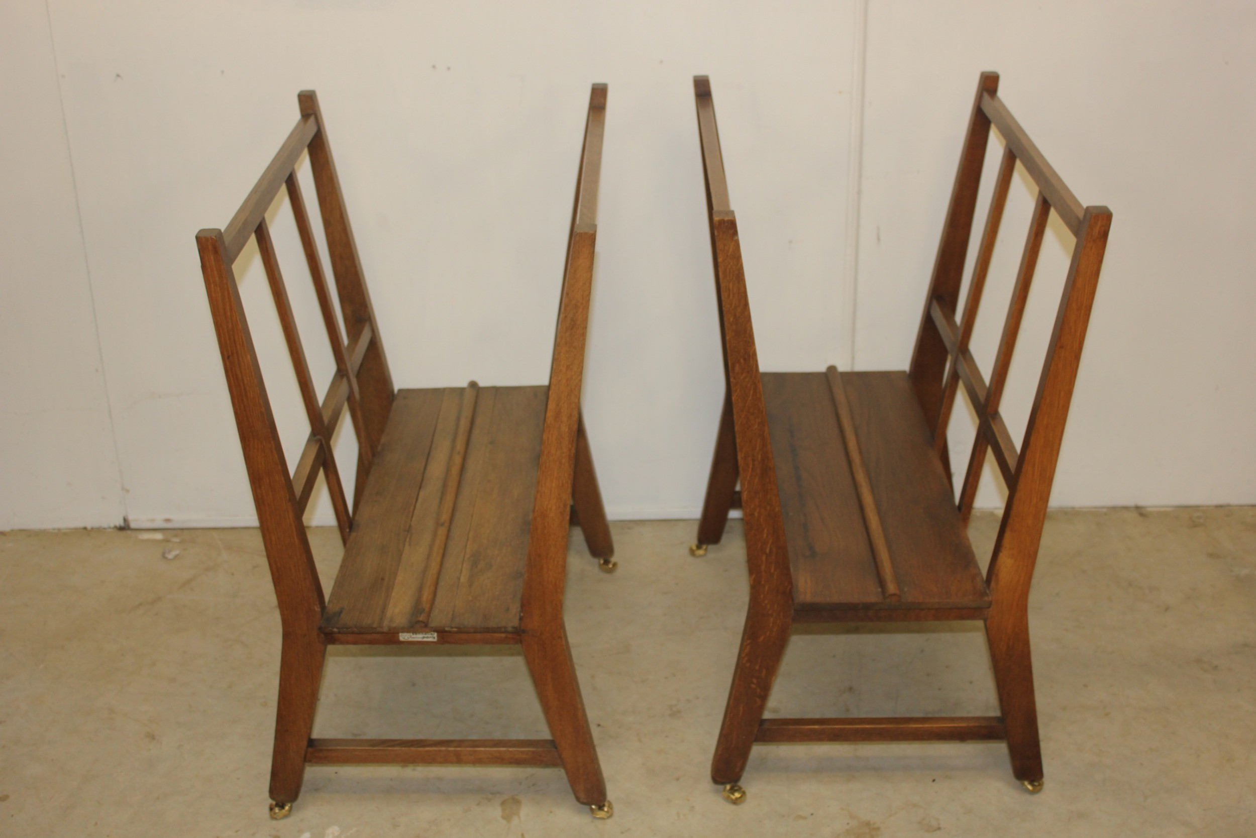 a pair of folio stands magazine stands