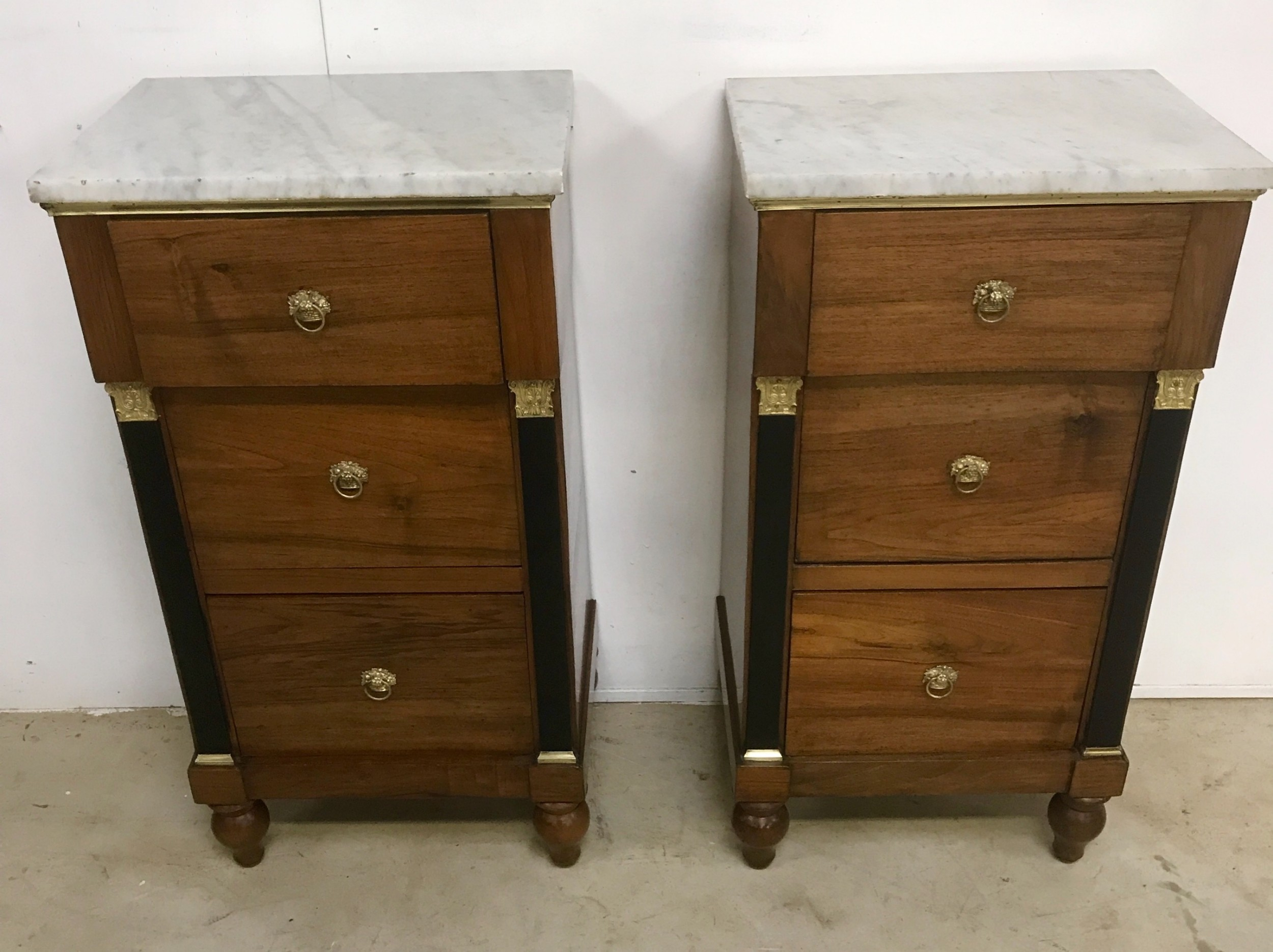 a pair of italian night stands