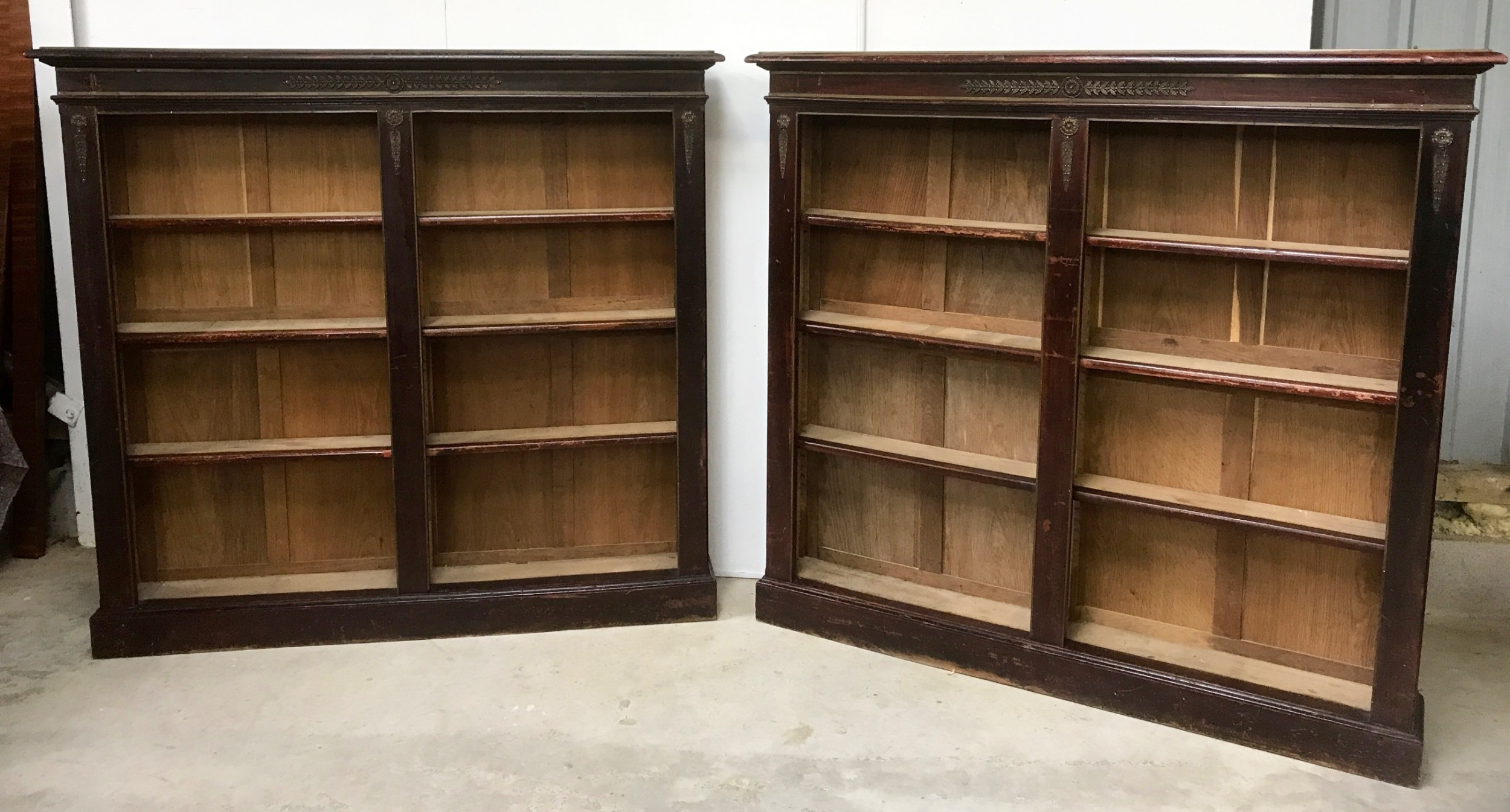 a pair of open bookcases