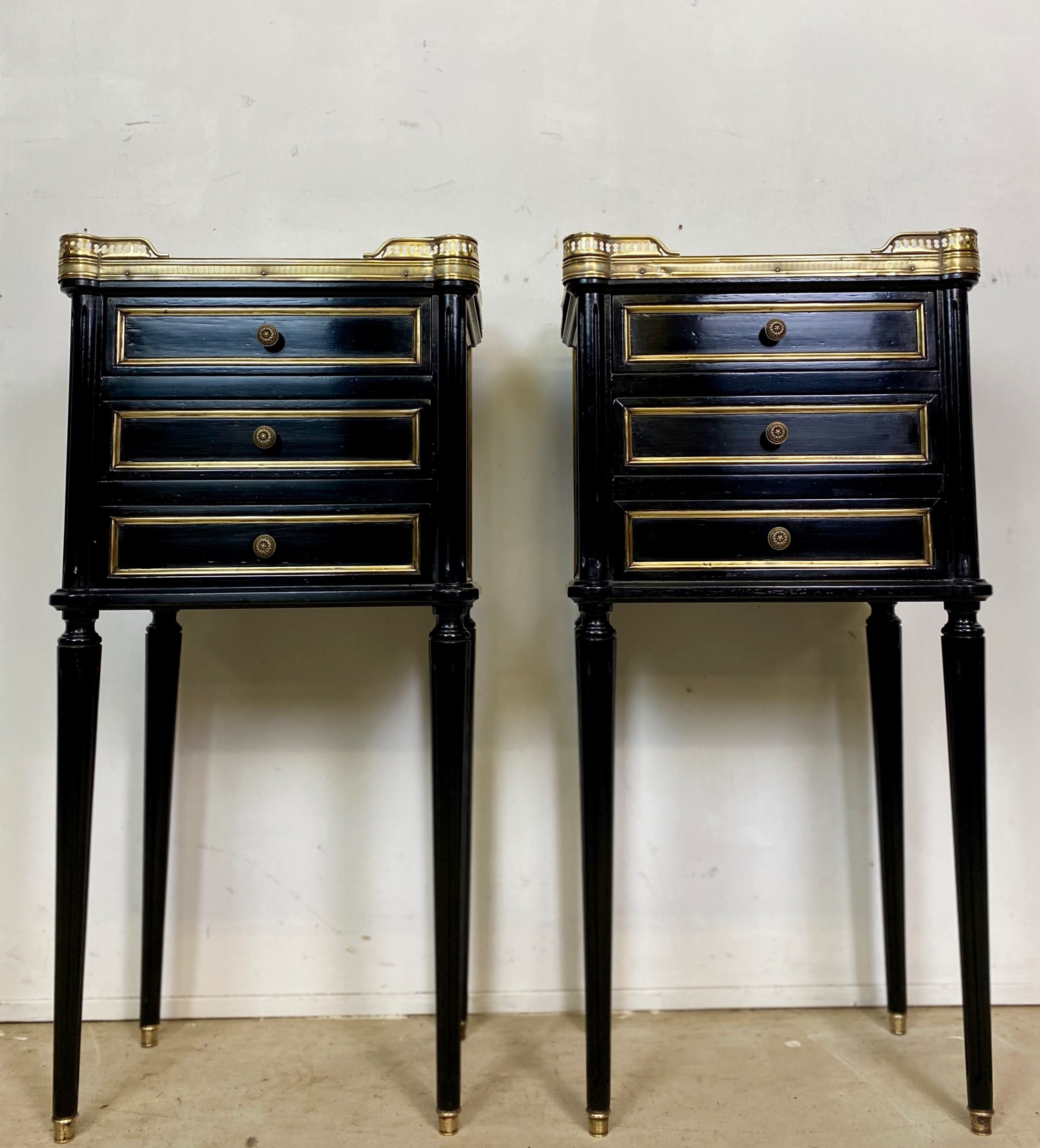 pair of french empire ebonised nightstands