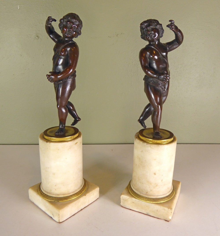 pair of regency bronze cherubs on marble bases