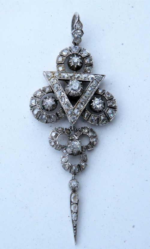 a superb diamond and platinum art deco pendant brooch set in the high art deco odeon style