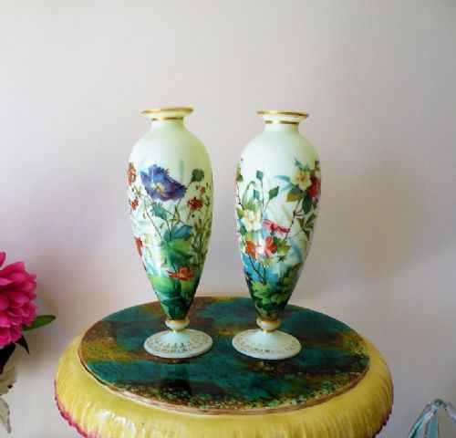 a superb pair of mid 19th century enamelled opaline glass vases