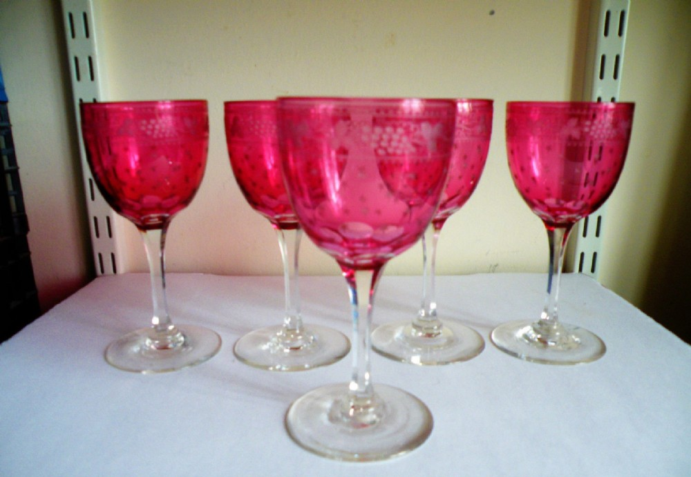 a good set of five victorian engraved cranberry glass wine glasses