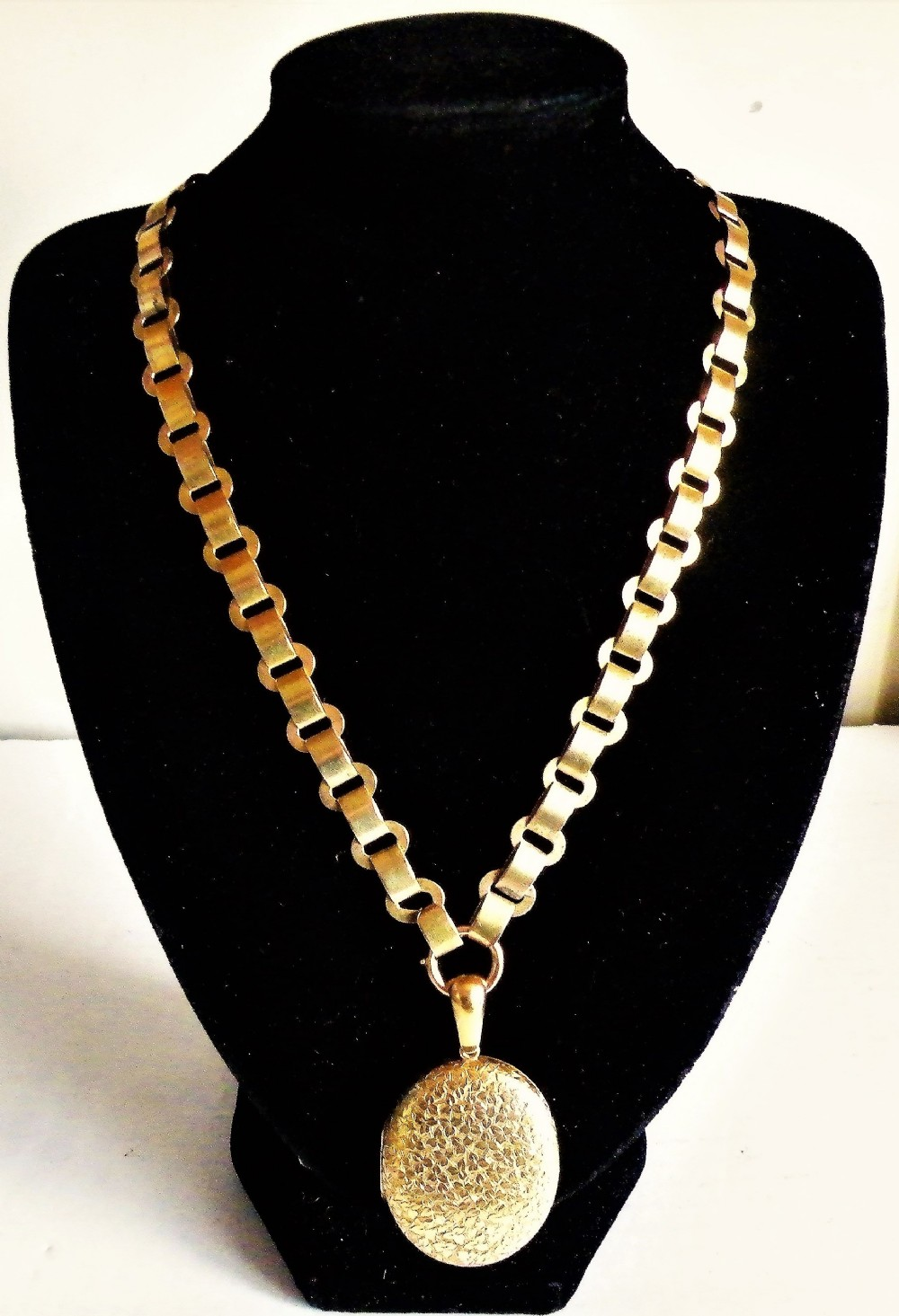 a good victorian 15 carat solid gold locket and chain