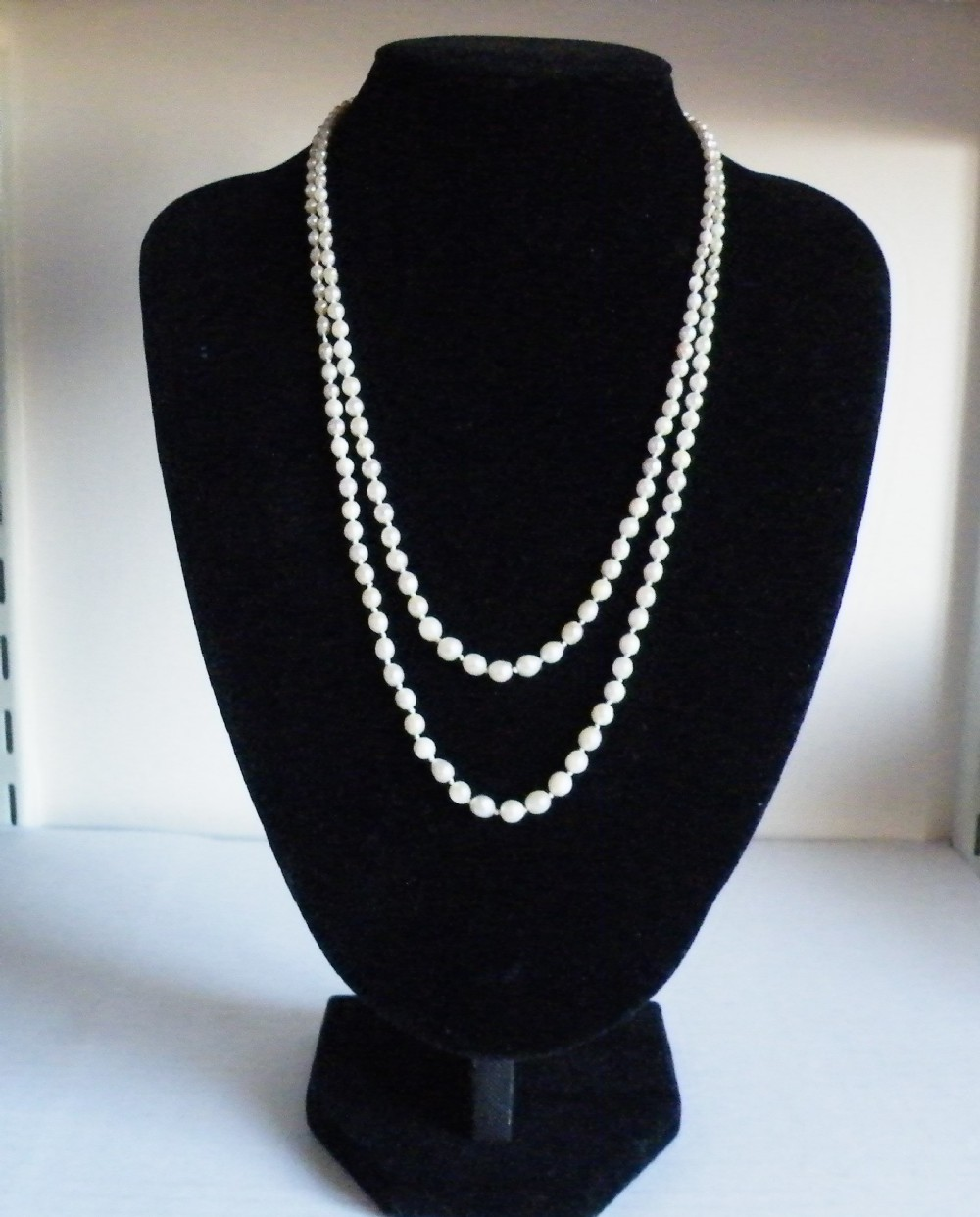 a 19th century double graduted natural pearl necklace with a diamond set clasp
