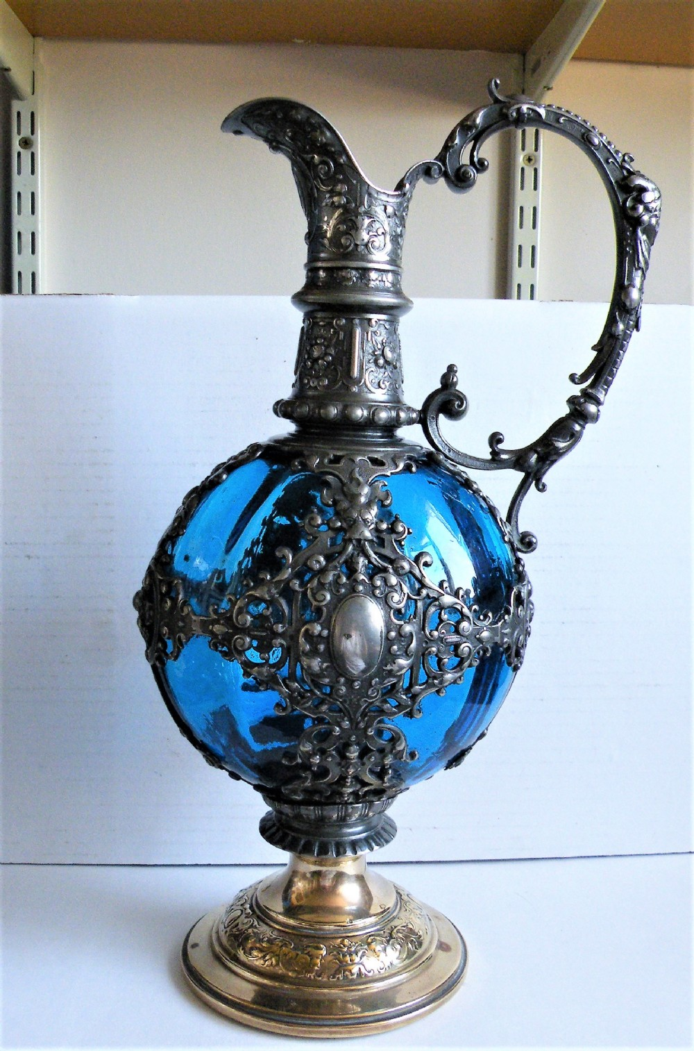 a 19th century bohemian blue glass and silver plated claret jug