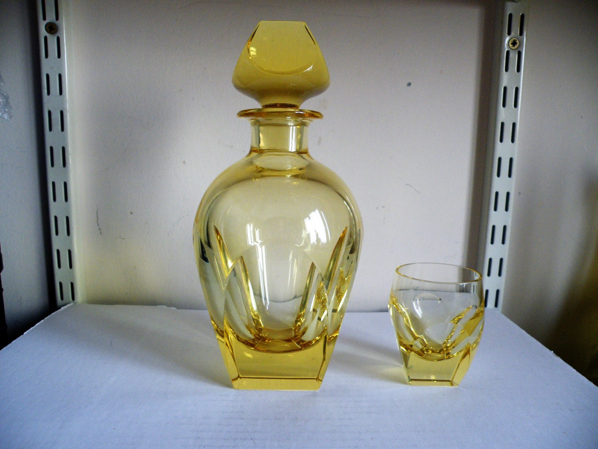 a citron colour art deco decanter and glass by moser of karlsbad