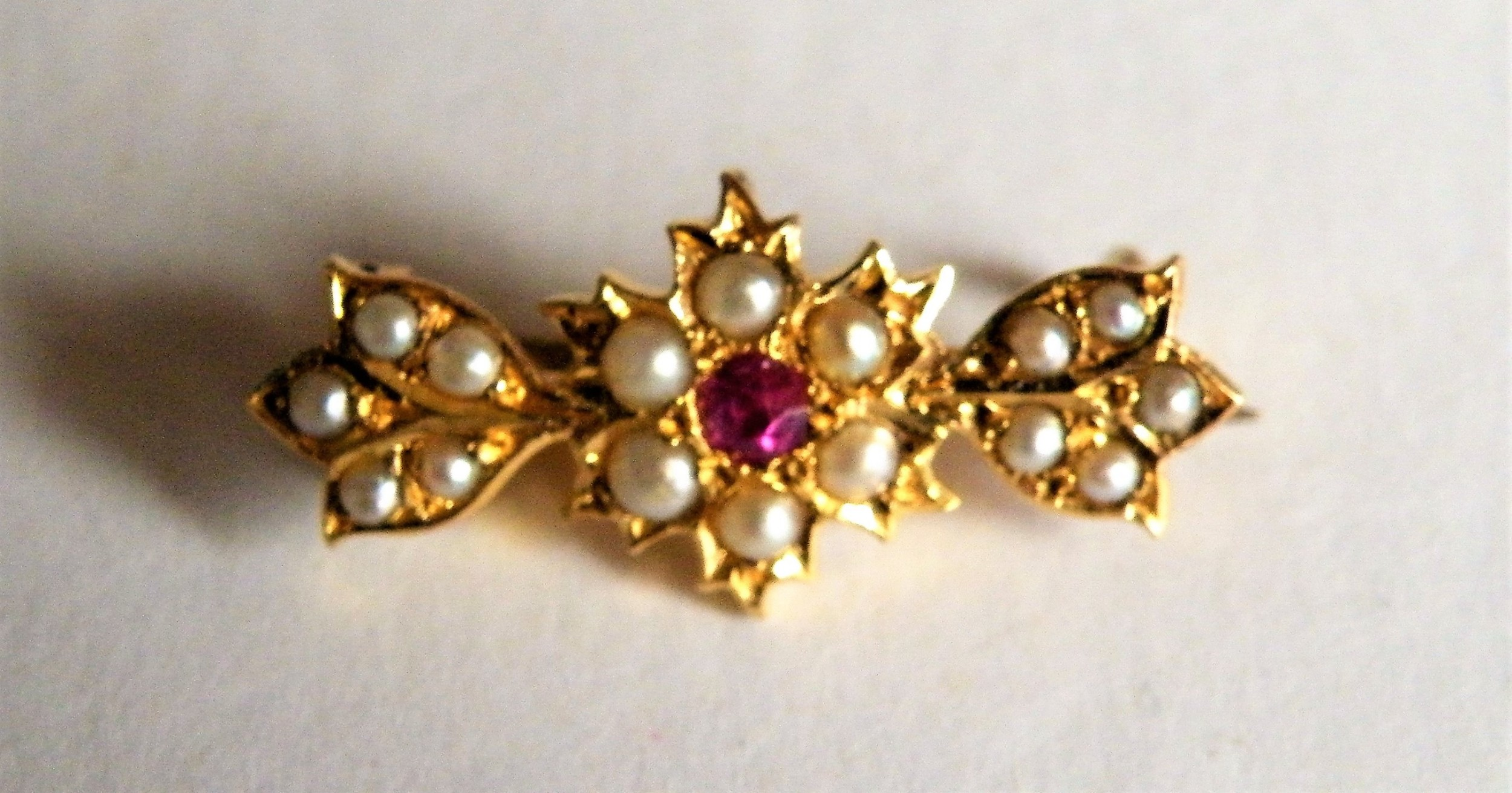 a pretty victorian gold ruby and pearl bar brooch