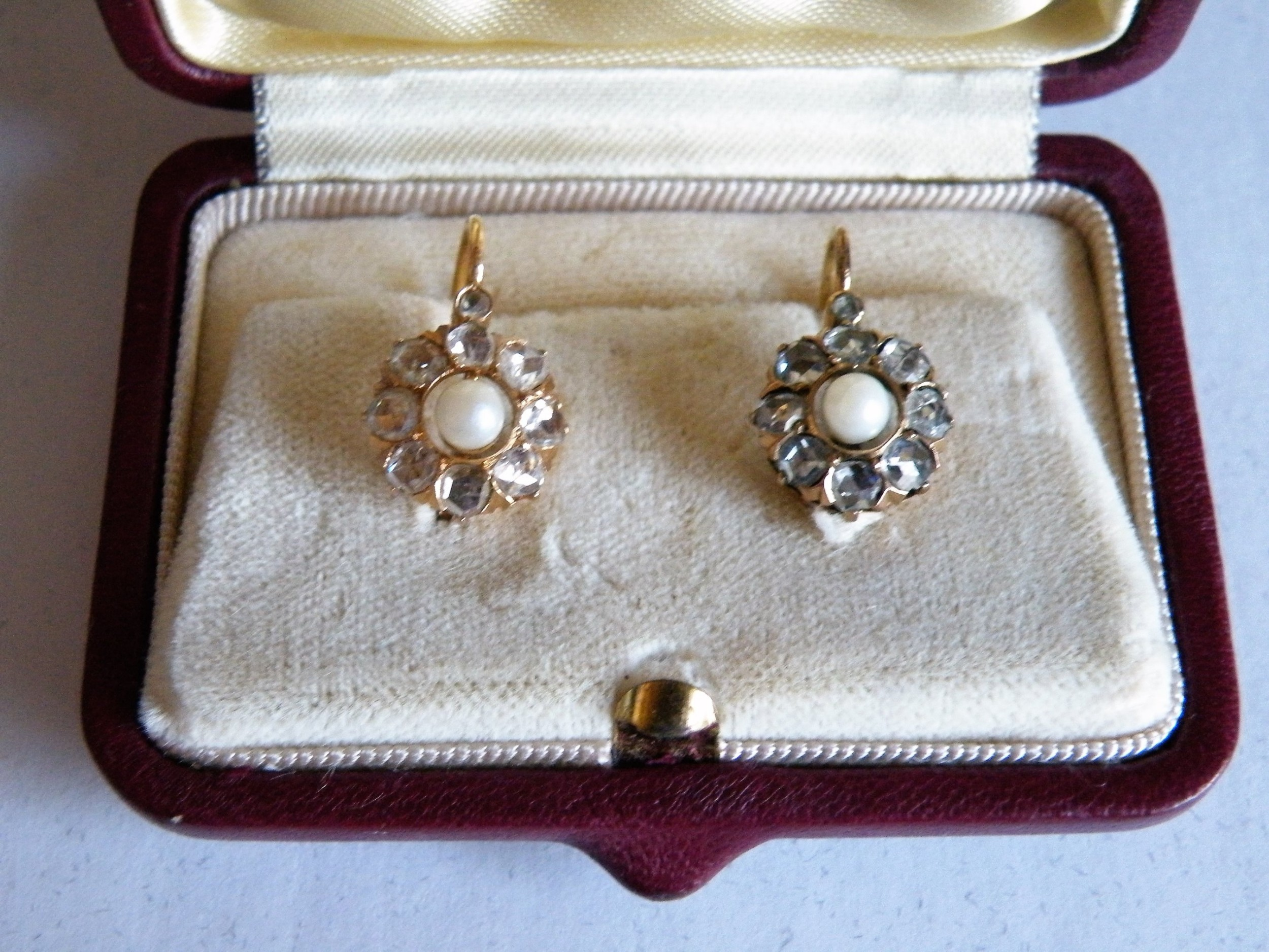 a good pair of victorian rose cut diamond and pearl earrings set in 18 carat gold