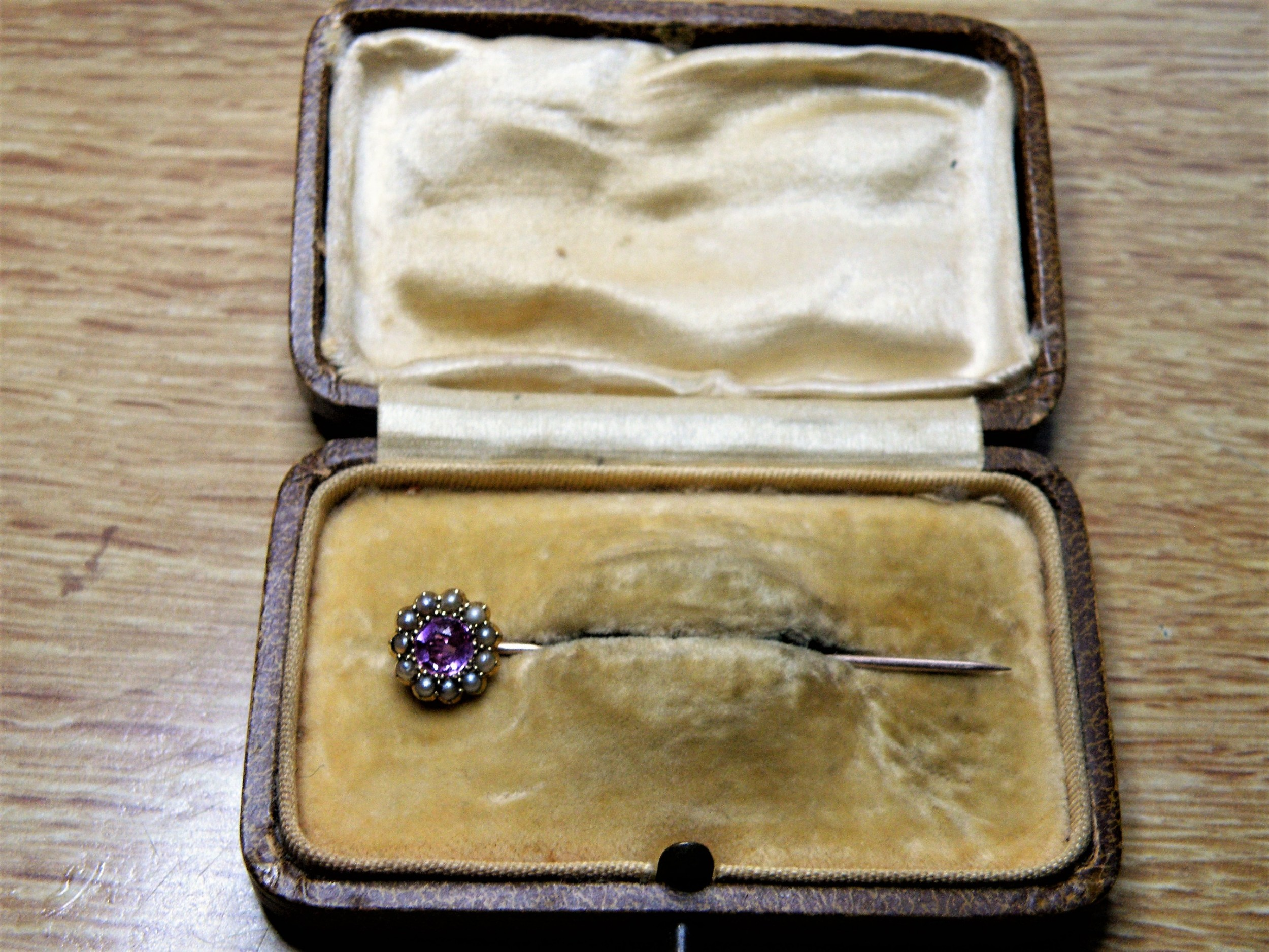 a nice victorian ruby and half pearl stick pin set in 15 carat gold boxed