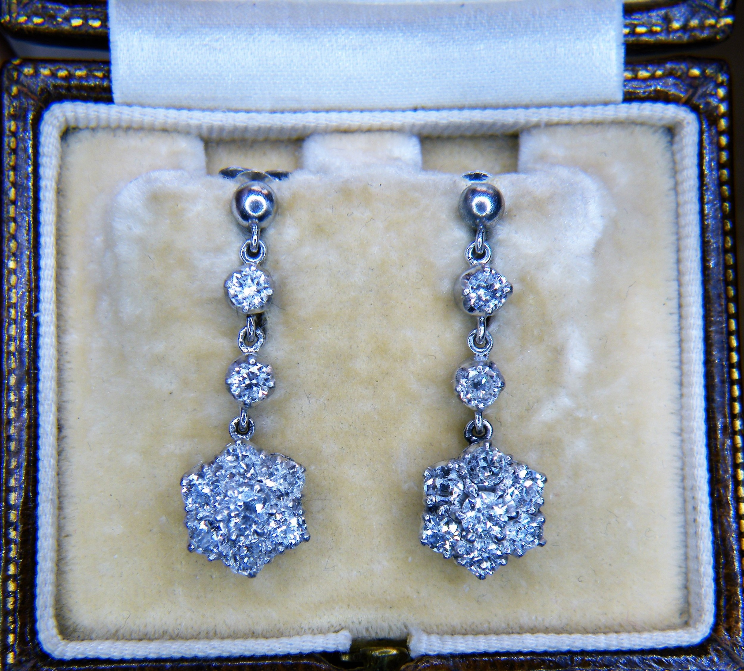 a pair of edwardian diamond and platinum cluster drop earrings