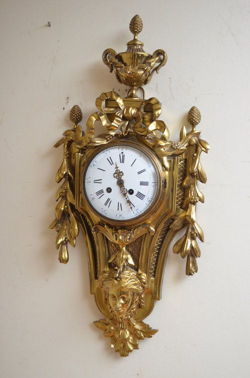 xix century gilt metal cartel clock wall clock