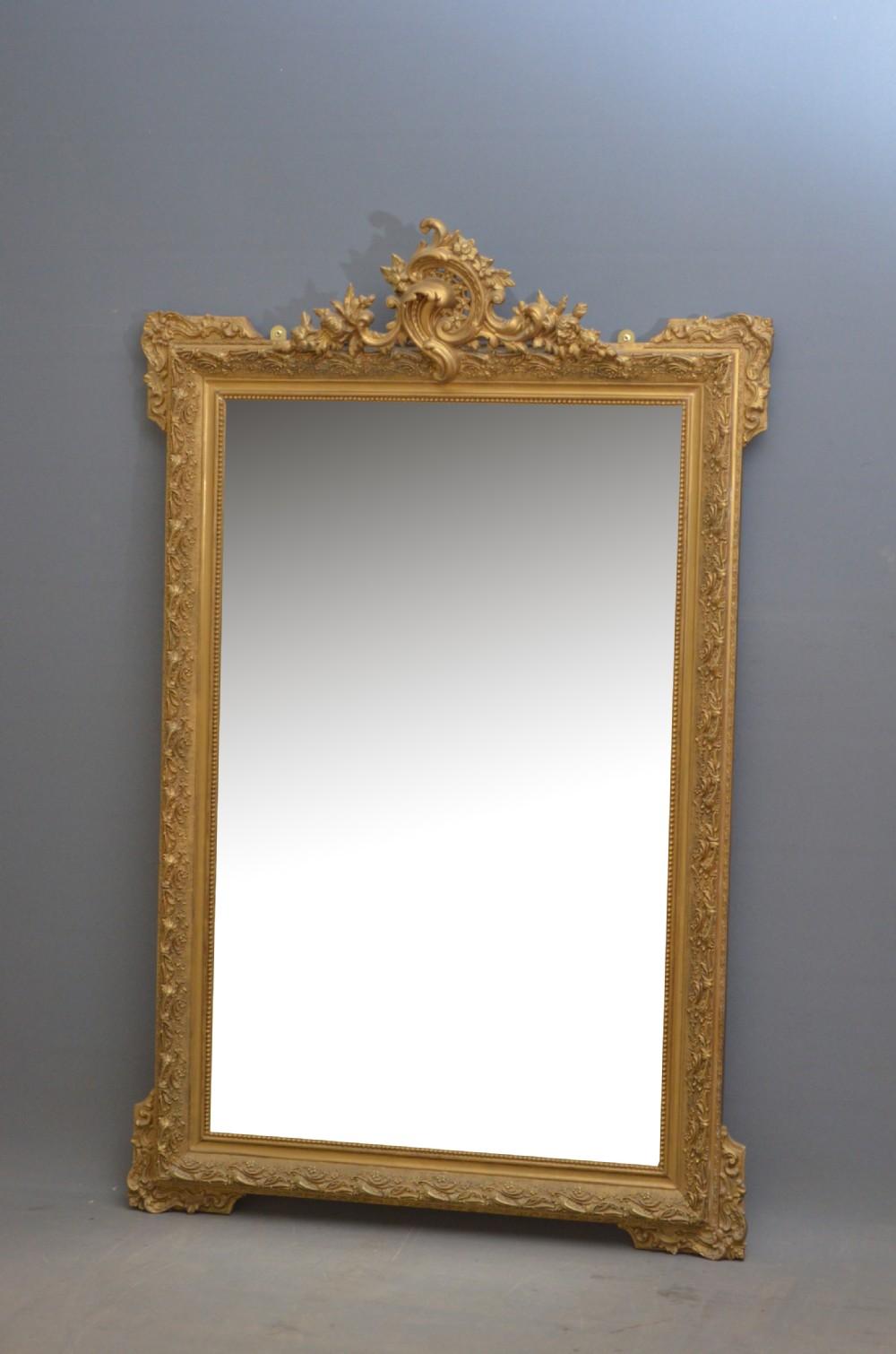 a very decorative gilt mirror