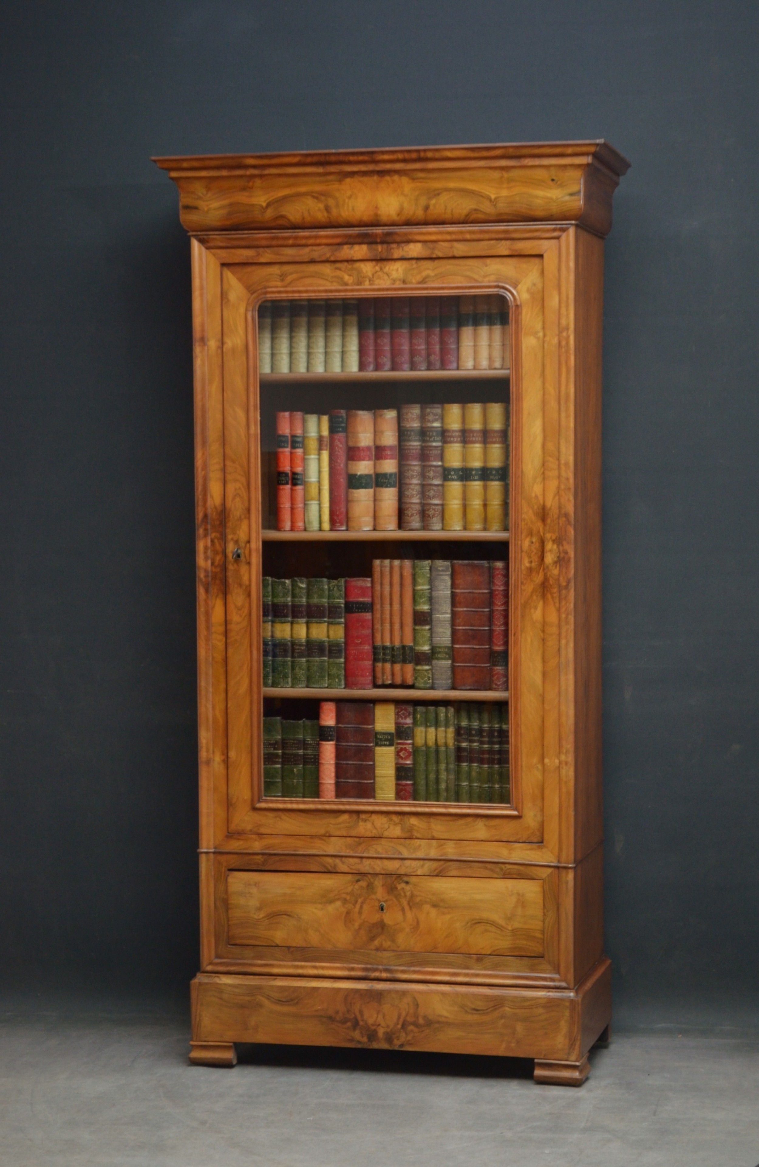 19th century continental figured walnut bookcase of small proportions