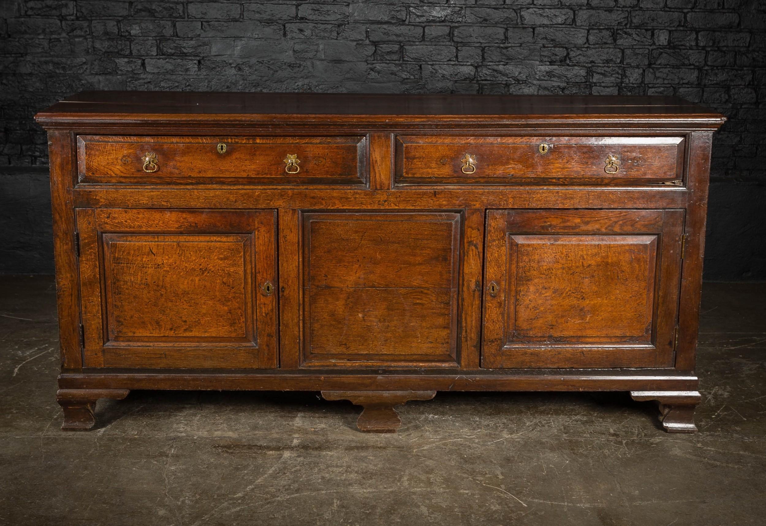 george ii oak sideboard with brass pull handles