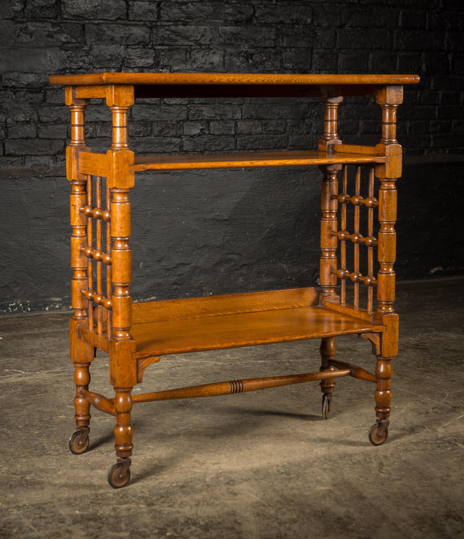 victorian arts crafts light oak finish bookshelf on castors