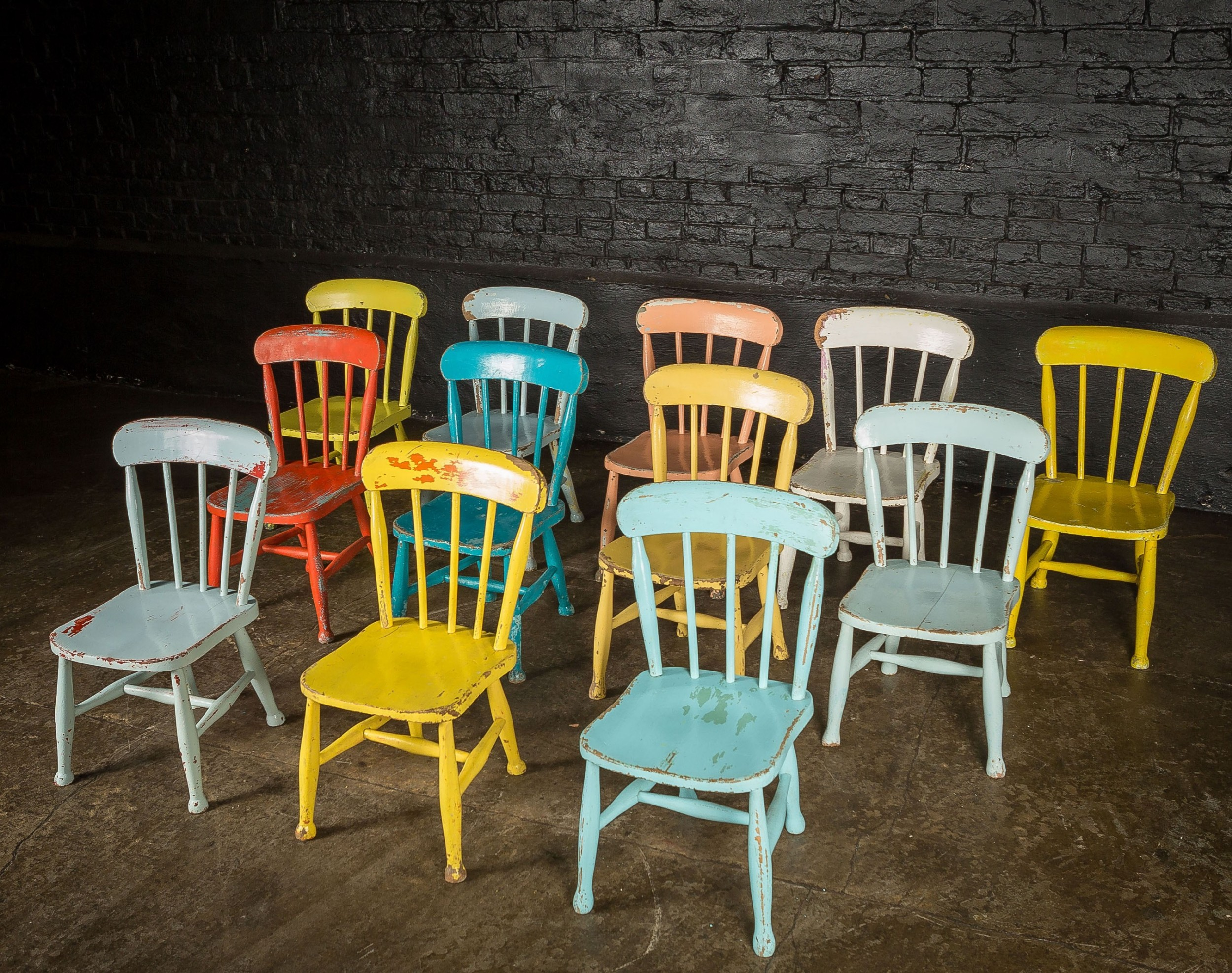 set of 12 victorian elm childrens chapel chairs painted in various colours