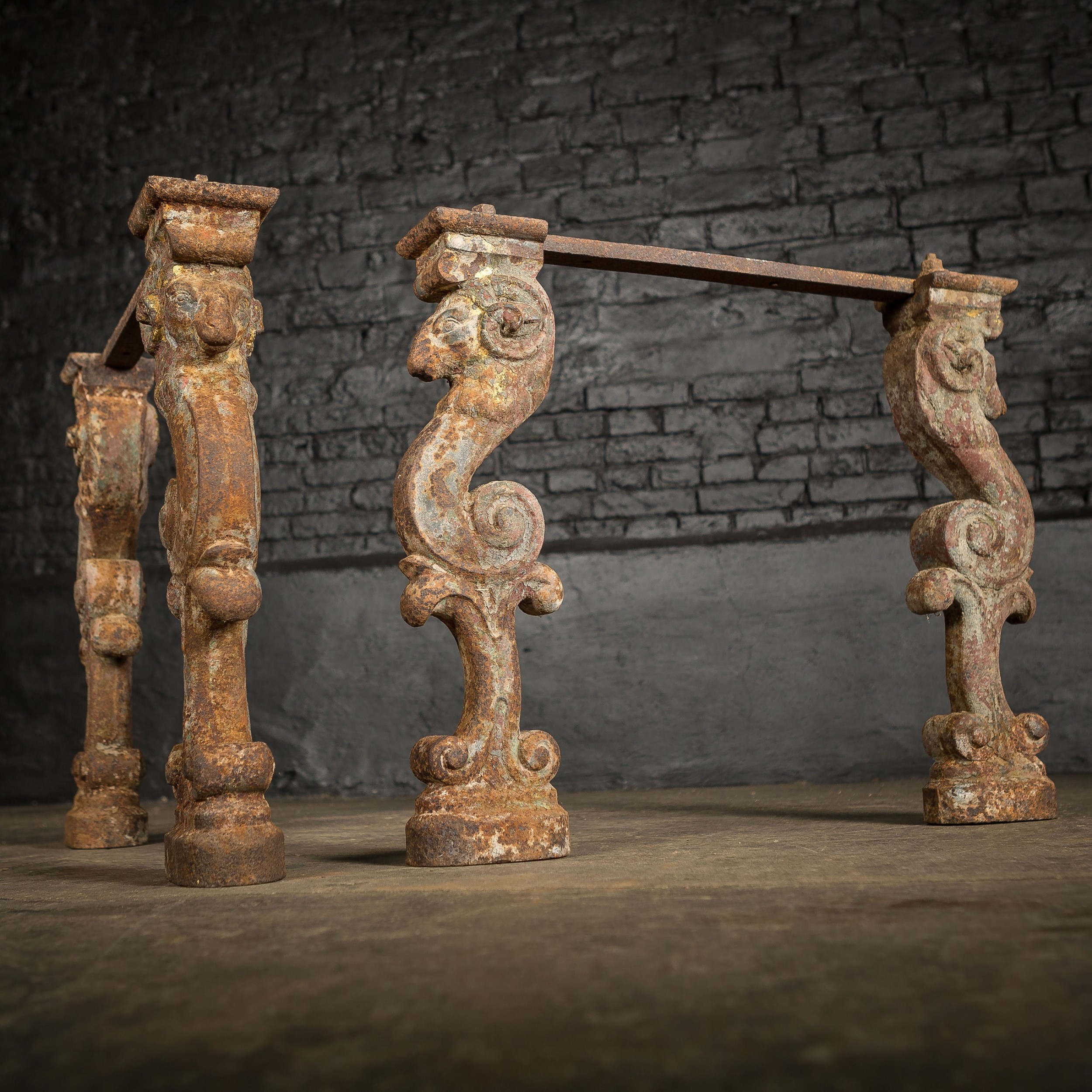 pair of 19th c gilded cast iron rams head table legs bases