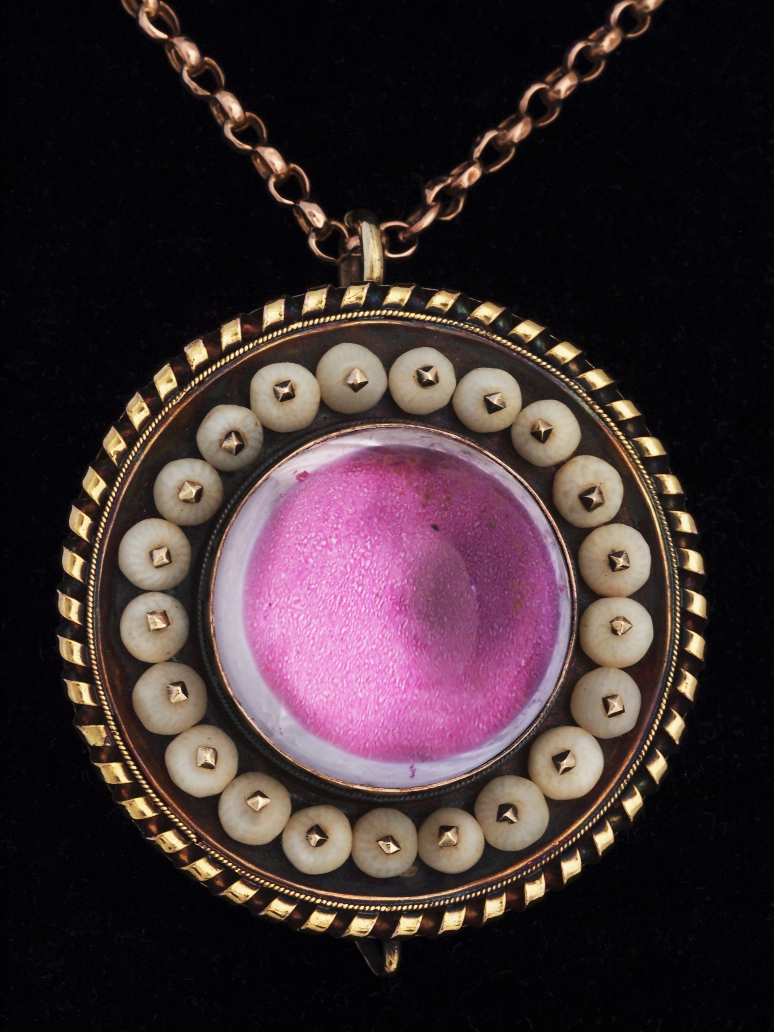 gold locket with white coral and rock crystal