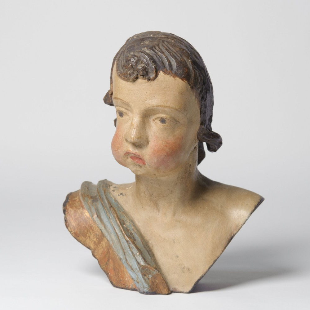 rare carved wooden head