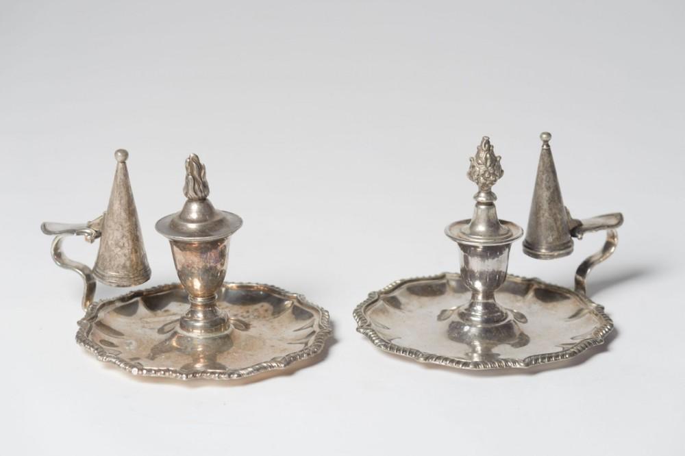 two silverplate pretty chambersticks