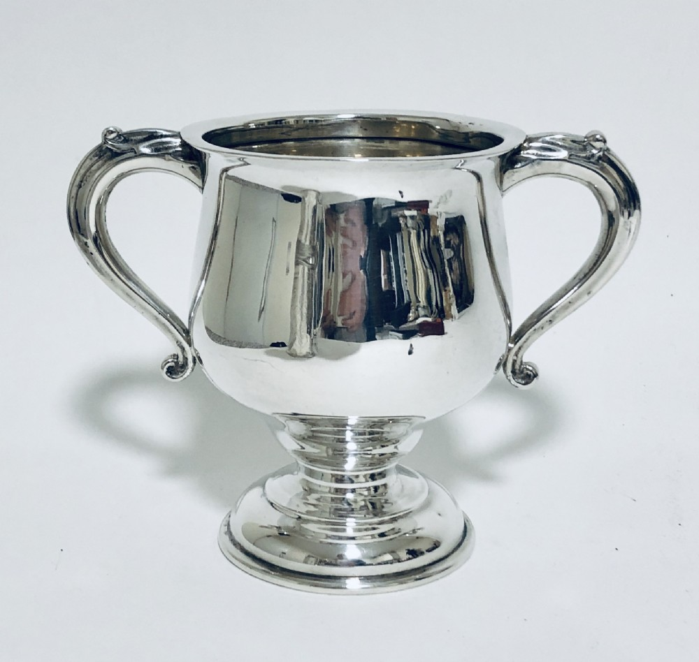 large antique solid silver twin handled trophy cup