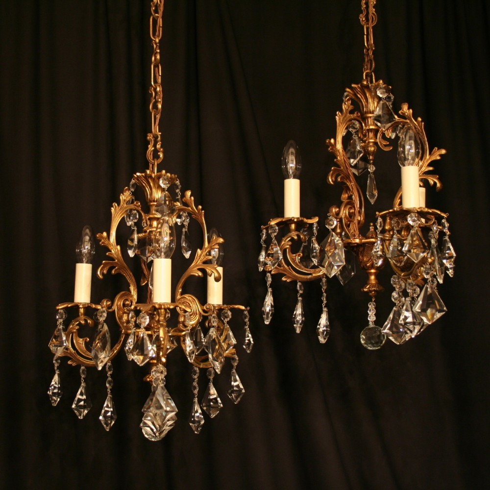 An italian pair of gilded cast brass crystal antique chandeliers an italian pair of gilded cast brass crystal antique chandeliers arubaitofo Images
