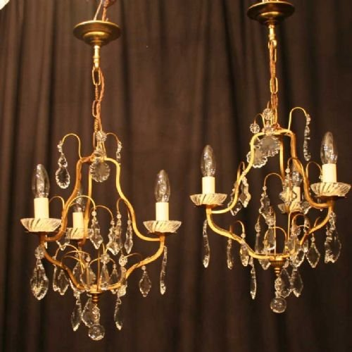 french pair of gilded triple light chandeliers