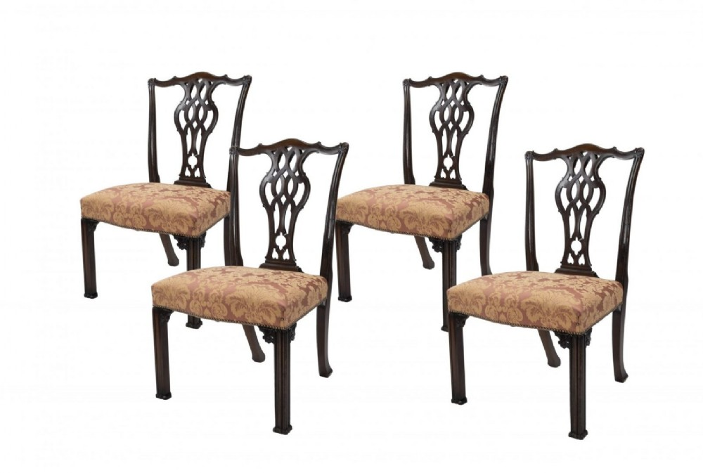 set of four carved mahogany chippendale style dining chairs