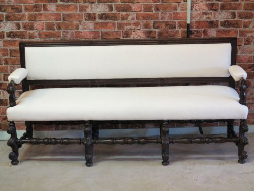 an 18th century upholstered settle