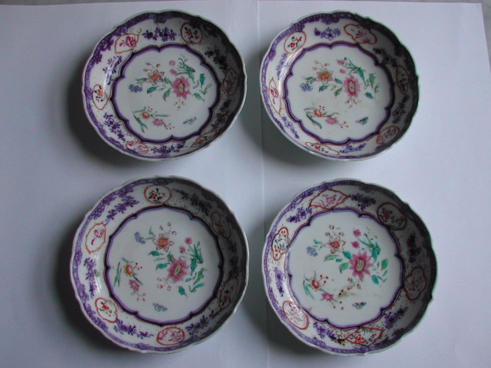 a set of 4 chinese underglaze blue and famille rose decorated saucer dishes circa 1750