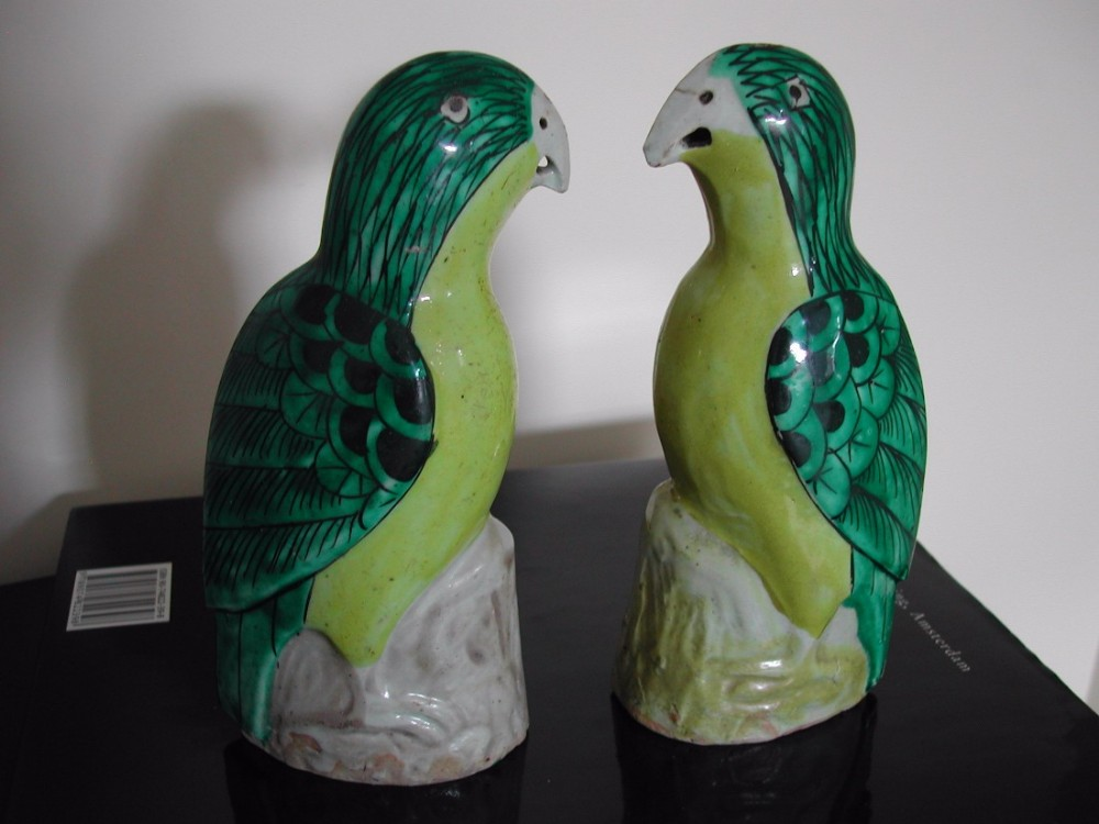 a pair chinese export figures of green and yellow glazed parrots 18th19th century