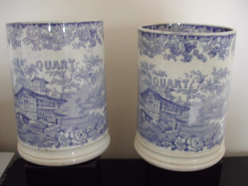 a pair of english pottery blue and white transfer print quart tankards circa 1830