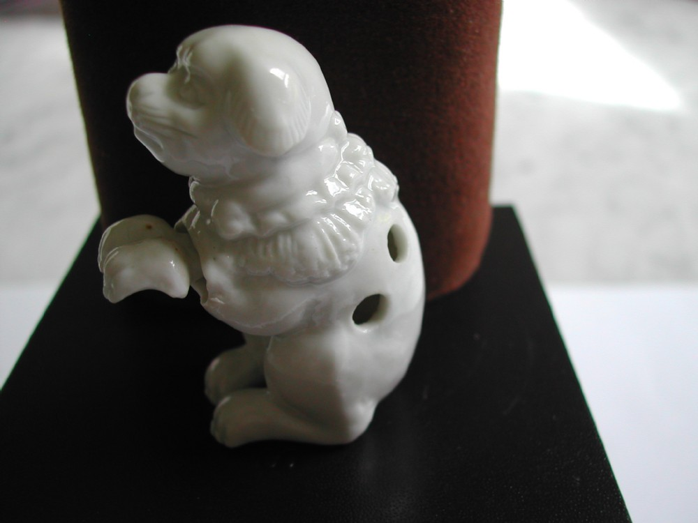japanese hirado porcelain novelty netsuke of a seated puppy dating to the meiji period