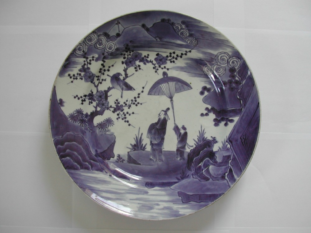 a very fine arita kakiemon style large blue and white dish dating to the early 18th century