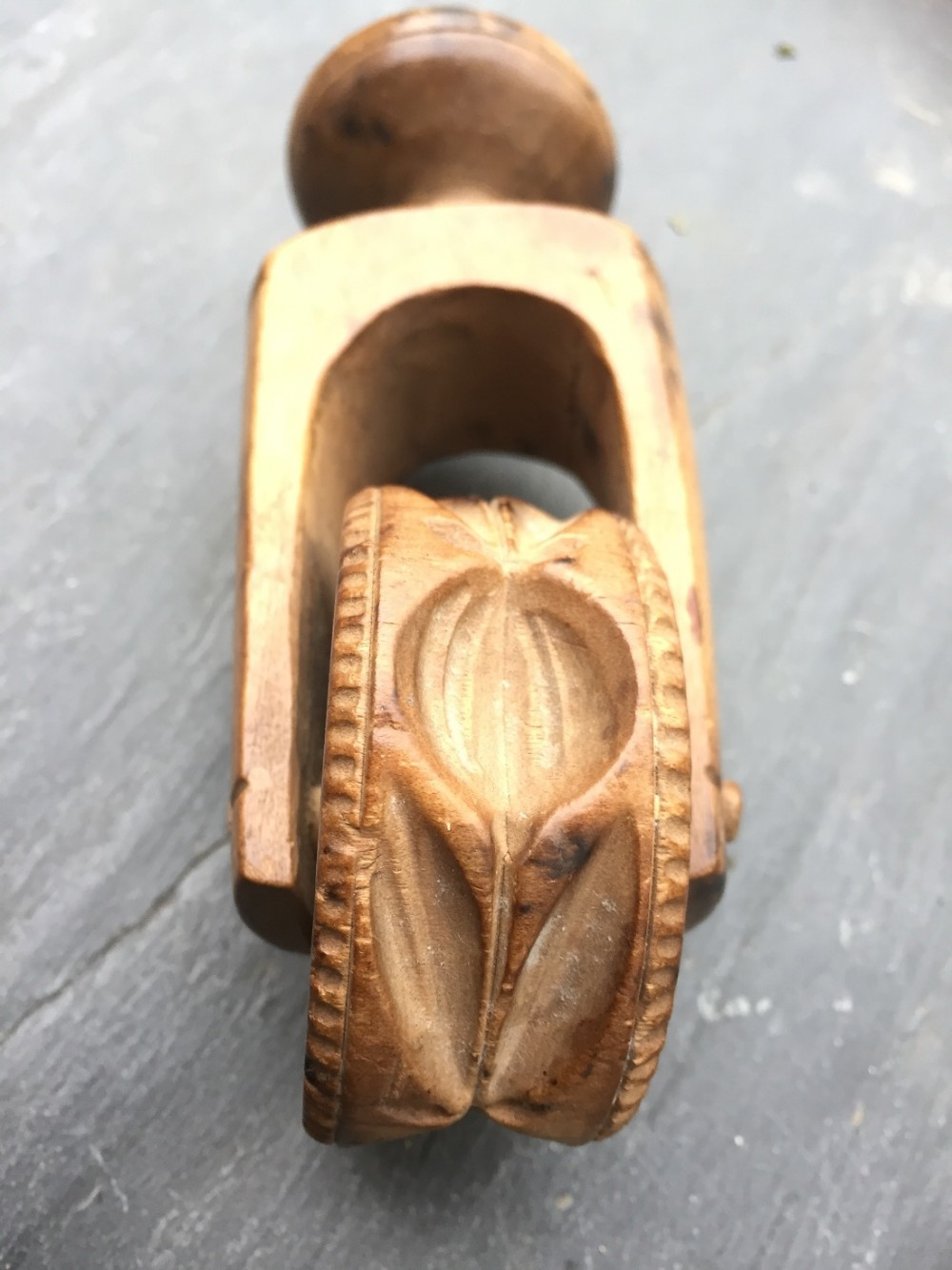A th century sycamore carved butter roller and pastry