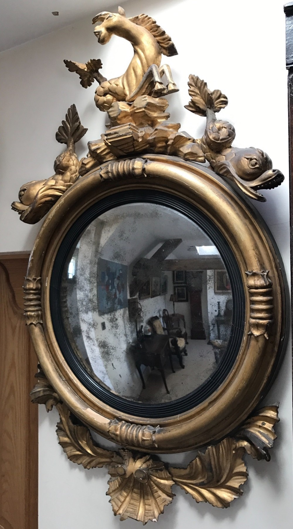 a large regency gilt convex mirror
