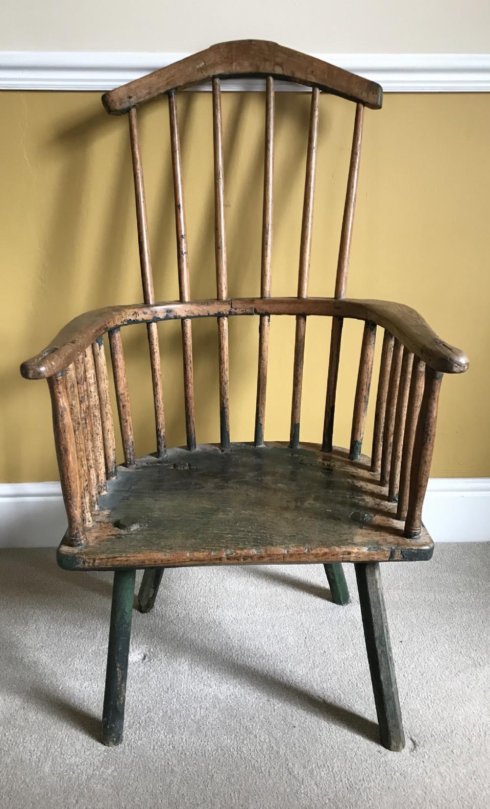 a 17thc primitive elm armchair